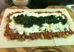 Layer ingredients of meat mixture, cheese and spinach on the pastry for this recipe for ground beef
