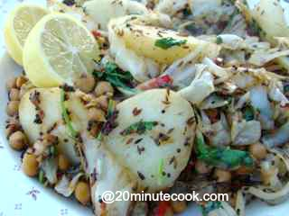 Cabbage salad recipe tossed with spices, coriander and coconut.