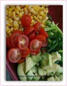 corn salad with cherry tomatoes, avocado and spring onions