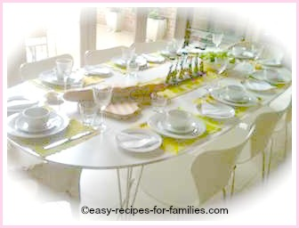 A table beautifully set for an elegant dinner party menu for twelve