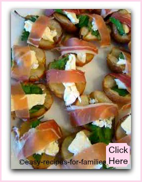 A healthy appetizer of roasted pears wrapped in proscuitto