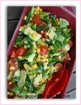 A Healthy recipe Salad of corn kernels, avocado and cherry tomatoes