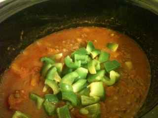 Stir through green peppers into this easy pumpkin chili just prior to serving
