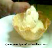 A scoop of homemade ice cream in a waffle cup