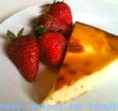 A slice from the honey cake recipe with a serve of strawberries