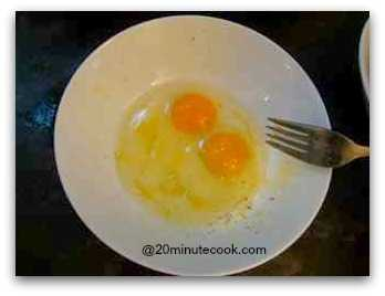 Break Two Eggs In A Bowl and Beat With A Fork