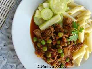 Savory easy ground beef recipe plated with short pasta and salad.