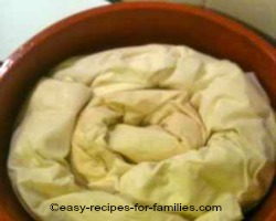Swirled rolls of filled filo pastry rolls