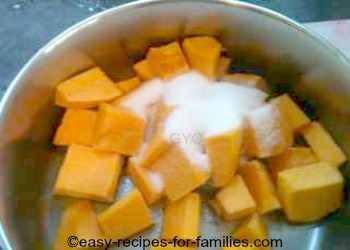 Stew the prepared pumpkin pieces in sugared or salted water