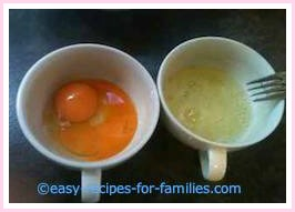 separated eggs in two bowls