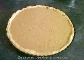 Pastry shell for this Low fat pumpkin pie recipe filled with pie filling ready for baking