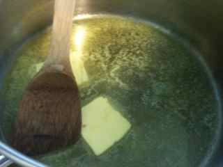 Melt butter to make the cake batter for gen's meals with ground beef - a layered ground beef cake