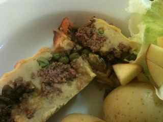 Plated layered ground beef cake, one of Gen's meals with ground beef
