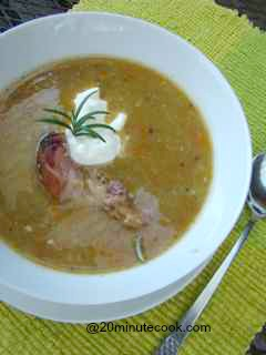 Split pea and ham soup served with chunks of ham on the bone and a generous dollop of greek yoghurt