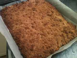 Delicious pumpkin crumble layered with pie crust, pumpkin and crumble