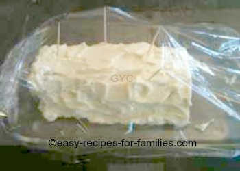 Top the pumpkin roll with clear plastic wrap drapped over the toothpicks