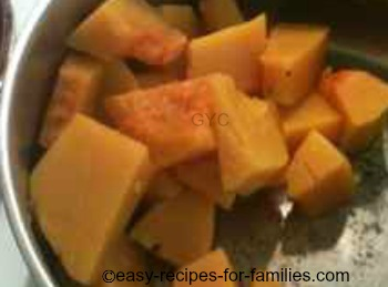 Cooked pumpkin in a saucepan, drained