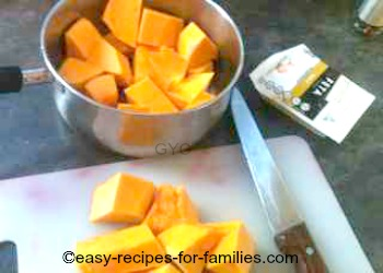 Diced pumpkin pieces in a saucepan