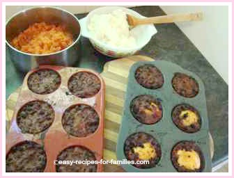 baked ground beef muffins with mashed toppings at the ready