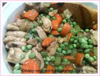 chicken pot pie filling in a casserole dish