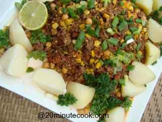 Ground Beef Salad Tossed with Corn, chick peas, tomatoes and simply boiled potatoes