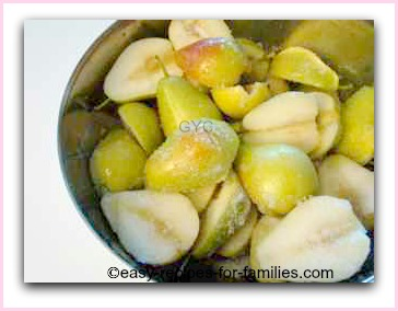 a bowl of halved pears coated with sugar