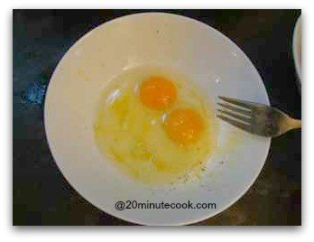 Two eggs ready to be beaten