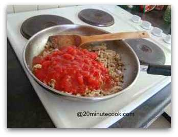 Add in canned tomatoes