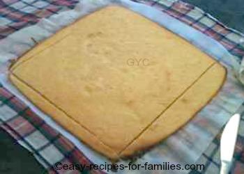 For the pumpkin cake roll, trim the edges to make the shape regular