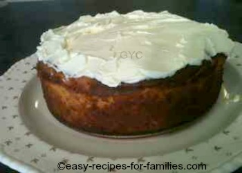 Cream spread all over the top of the pumpkin cheese cake