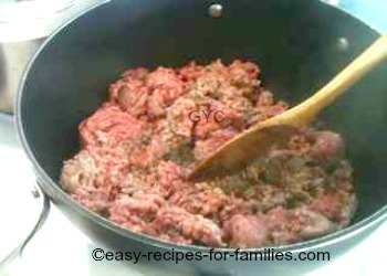 Meat being browned in a non stick pot