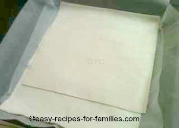 Pastry sheets for the pumpkin pie squares, in a lined square pan