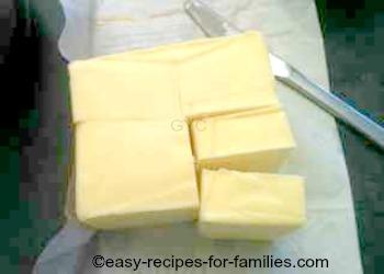 Cut butter into a 2 oz/60 gm block